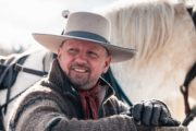 Cowboy guide Mike on a sleigh ride with Banff Trail Riders