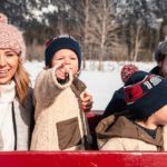 Family Banff winter sleigh ride with Banff Trail Riders