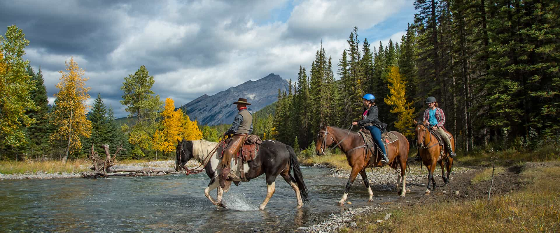 Guided river crossing horseback ride with Banff Trail Riders