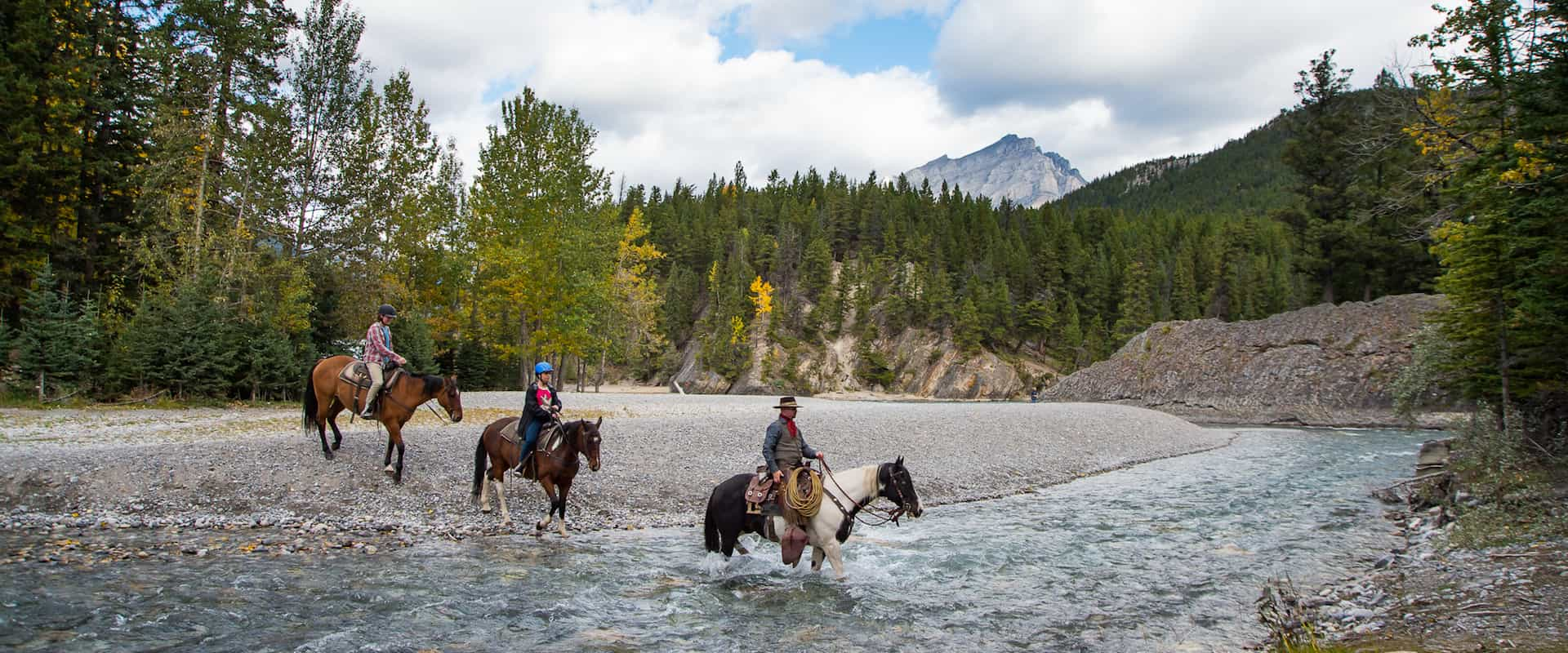 Horseback ride through the Spray River with Banff Trail Riders