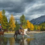 Ride through the Spray River with Banff Trail Riders
