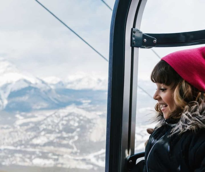 See views over Banff from the gondola cabin