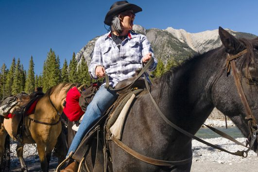 Fun on a horse on the Sundance Overnight Backcountry Lodge Trip in Banff, Canadian Rockies with Banff Trail Riders