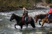 Ride through a river on a Backcountry Vacation