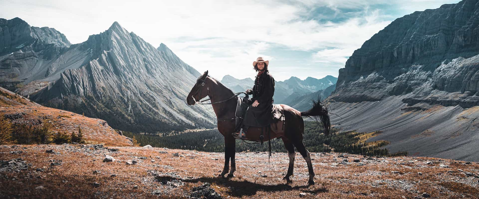 Ride to the summit at Allenby Pass with Banff Trail Riders in the Canadian Rockies