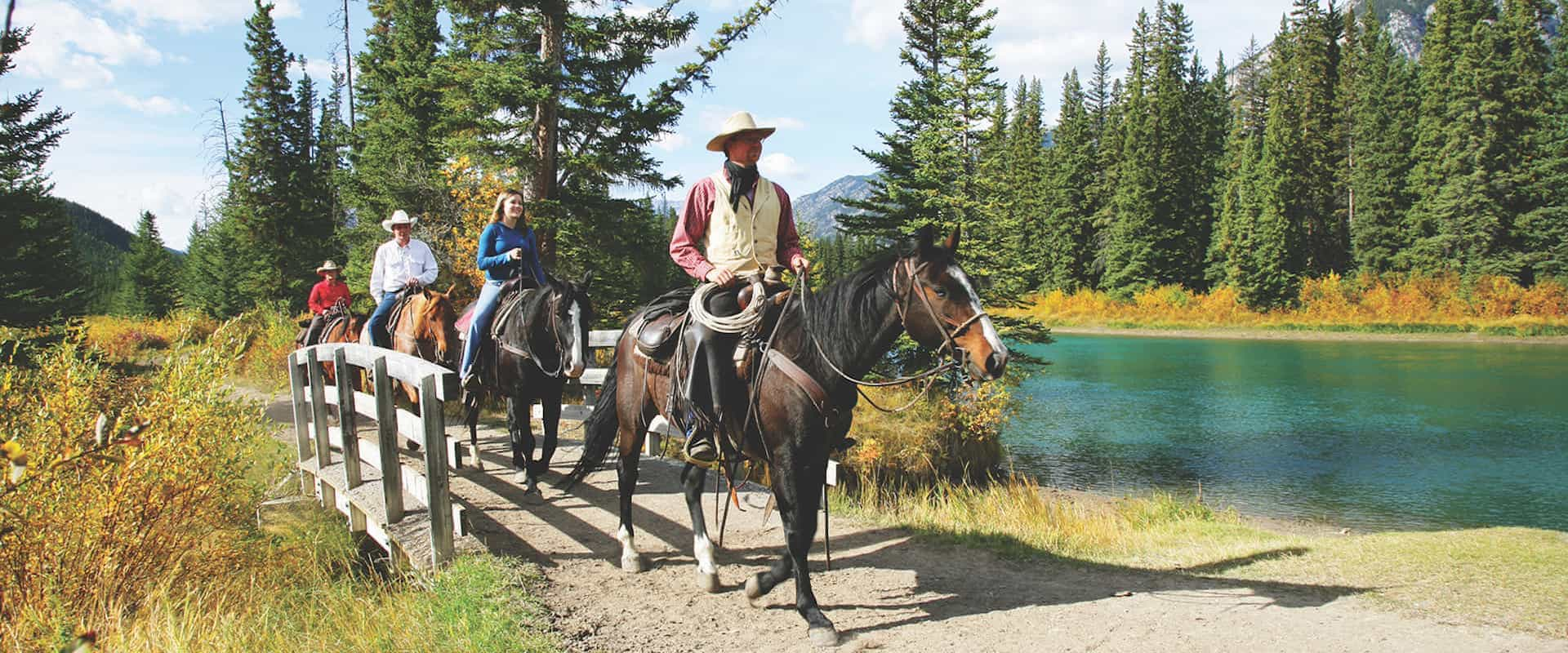 Ride along the Bow River on a horseback ride with Banff Trail Riders