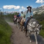 Follow your guide on a scenic Bow River horseback ride with Banff Trail Riders in the Canadian Rockies