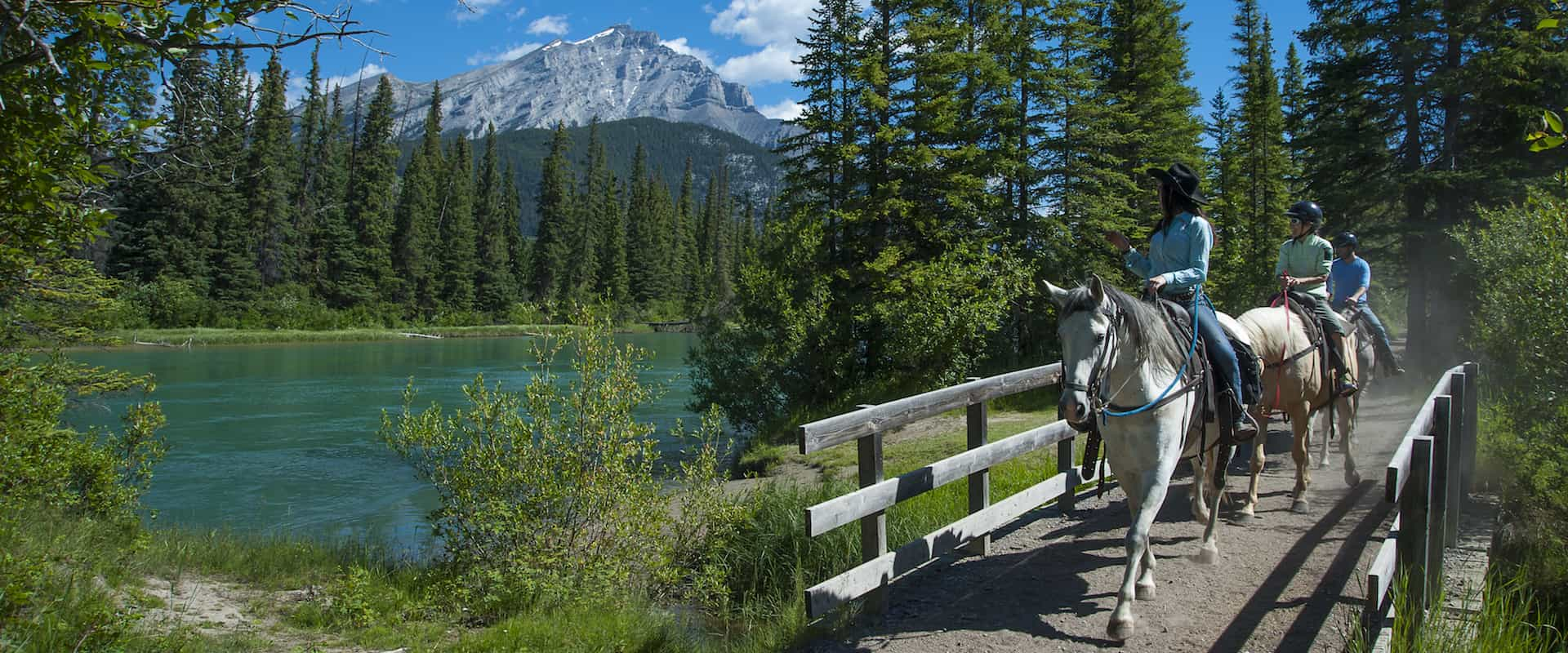 Ride along the Bow River on the Bow River Ride with Banff Trail Riders in the Canadian Rockies