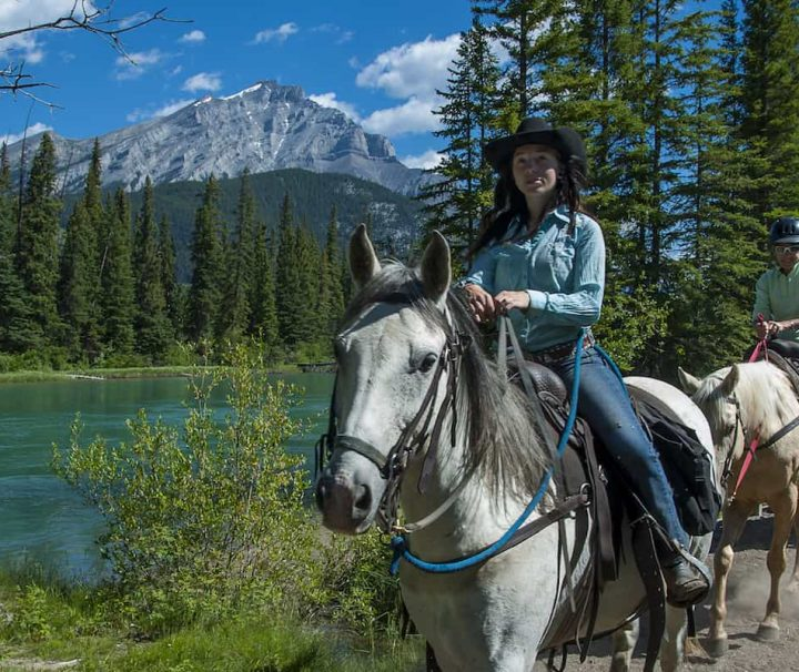 Take a guided horseback ride along the Bow River with Banff Trail Riders in the Canadian Rockies
