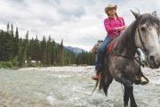 Crossing the river in front of Stoney Camp on the Stoney Creek Backcountry Tent Trip with Banff Trail Riders in the Canadian Rockies