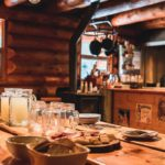 Dine at the large kitchen table at cozy Sundance Lodge