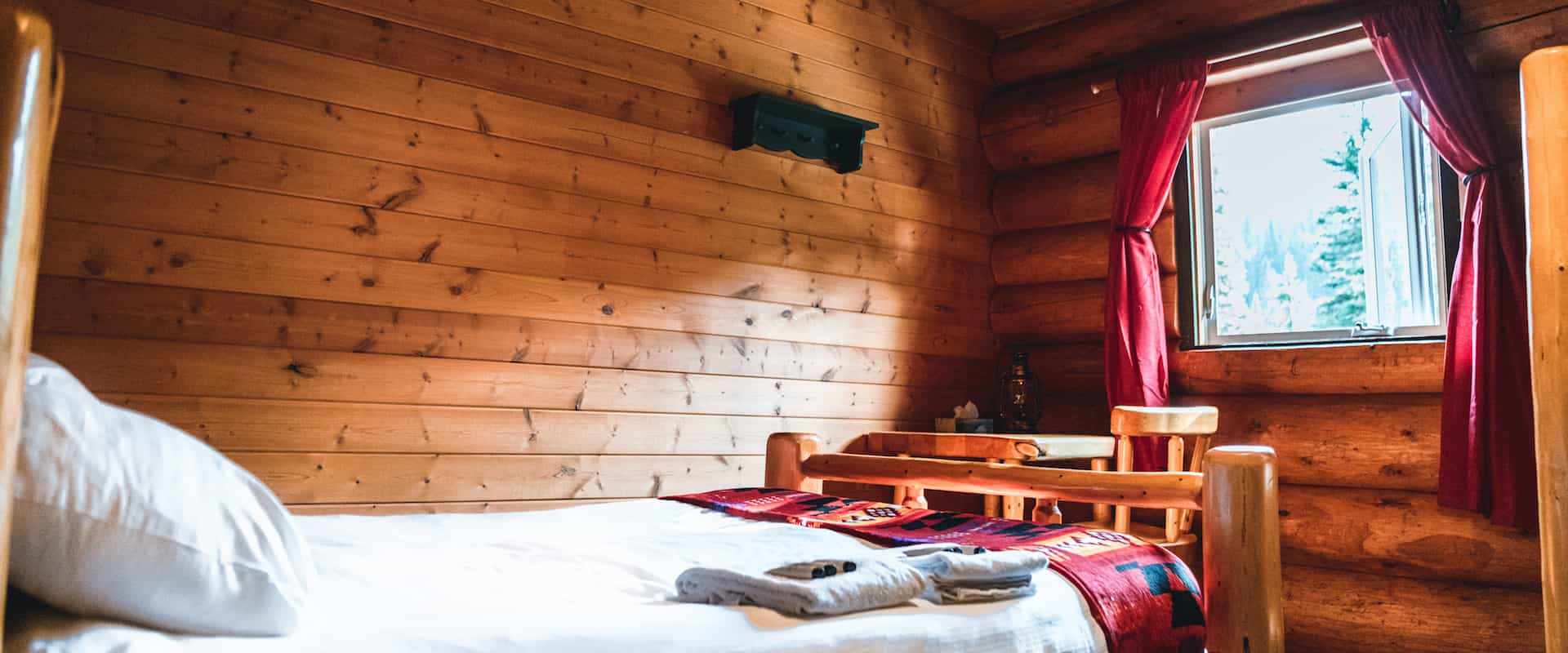Sleep in a comfortable bed at cozy Sundance Lodge