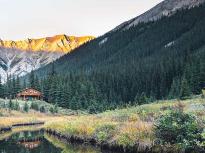 Stay in rustic comfort at log cabin Halfway Lodge on a backcountry vacation